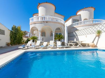 Photo for This 4-bedroom villa for up to 8 guests is located in Empuriabrava and has a private swimming pool a