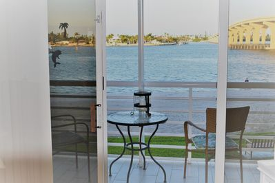 Balcony looking at the water, it is not screened in. Electric bbq for grilling.