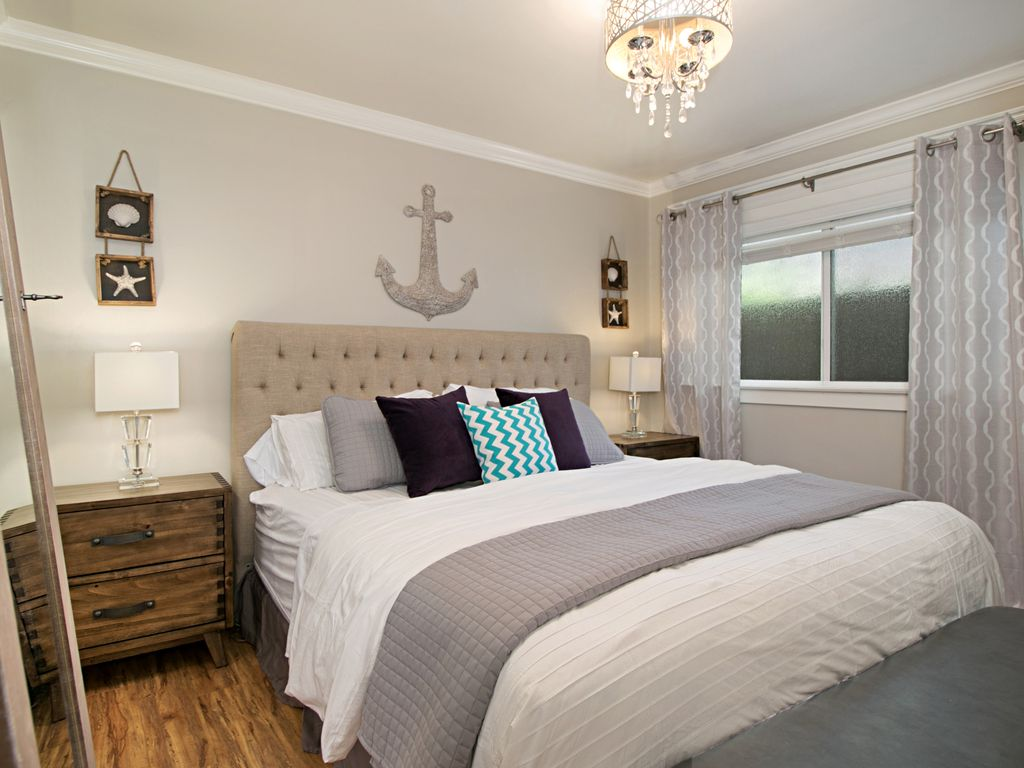 Beach cottage master bedroom - Chic Stylish Master Bedroom Boasts A King Bed With A Thick Pillow Top Mattress