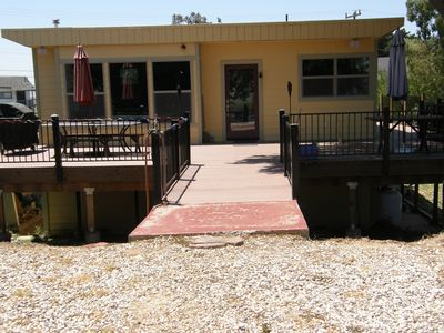 Waterfront house with large deck and dock.  WiFi, No cable TV