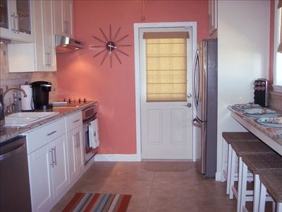 Granite Counters, Stainless Appliances and Large Breakfast Bar. Fun Retro Decor!