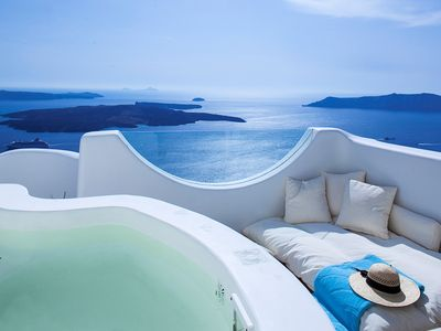 Photo for Superb Native Villa in Imerovigli Santorini, 4 Bedrooms, 4 Bathrooms, Jacuzzi, Up to 8 Guests, Breathtaking Sunset View !