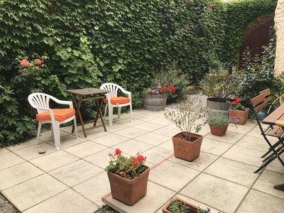 Lovely terrace on two levels for summer dining and relaxing . Walled garden