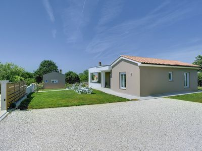 Photo for New holiday home for sole use with 2 bedrooms, 2 bathrooms, washing machine, air conditioning, WiFi, table football, terrace and barbecue