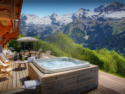 Photo for A hot tub and three terraces make the most of mountain views - SnowLodge
