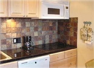 Remodeled Kitchen with Granite, Slate, New Cabinets and Appliances