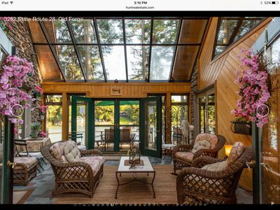 Glass Atrium between guest houses.  Shared space with owner.