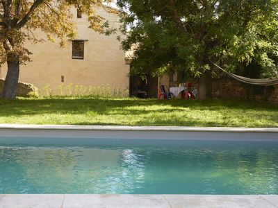 Photo for lovely provencal farmhouse with pool in heart of village