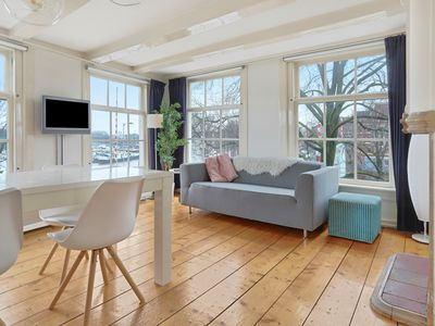 Photo for Historic two bedroom apartment, housing up to four guests, overlooking the scenic Oosterdok in the h