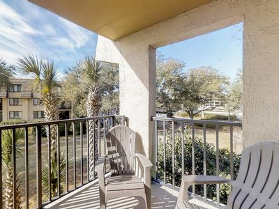 Photo for NEW LISTING! Lovely condo w/ ocean views, shared pool, hot tub, & sports courts!
