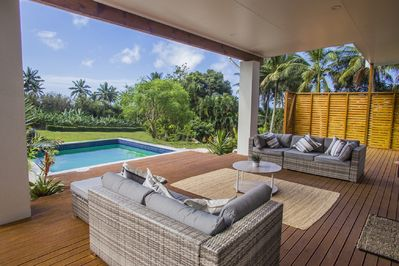 Open large deck opens up to pool and amazing view