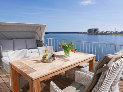Photo for Modern duplex apartment with water view, terrace, whirlpool and WiFi