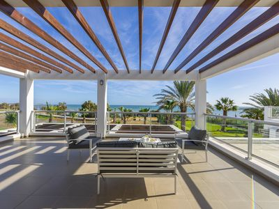 Photo for Truly Spectacular FirstLine Sea Front Villa in the beautiful village of Pervolia