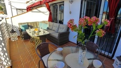 Photo for Spacious apartment overlooking the sea and mountains, terrace, pool, aircon, free Wifi