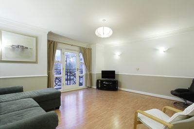 Living room with stunning views across the marina.  Sky TV with 500+ channels
