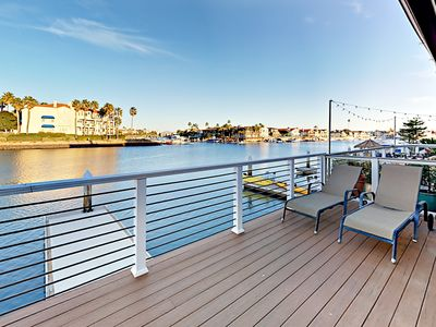 Deck - The home includes kayaks so you can go paddling right from your own dock!