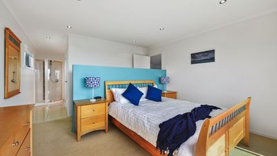 Upstairs main bedroom with spacious ensuite has Queen bed and ocean views!