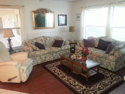 Spacious Living Room over looks pond & pool & comes with a new 32' TV, VCR & DVD