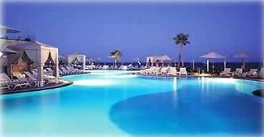 One of Five large infinity pools with swim-up Palapa bars and jacuzzis
