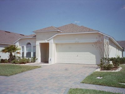 Photo for Luxury 4BR Villa + Pool & Spa- 15 Minute from Disney World