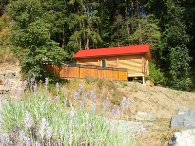 The cabin has a beautiful cedar fence that provides guests with complete privacy