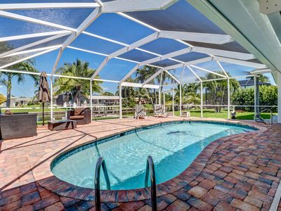 Photo for Desirable SE Cape Coral Yacht Club Area, Gulf Access Canal, Large Outdoor Area w/Pool, Free WIFI