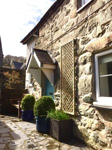 Photo for A charming traditional Welsh stone cottage set within a private courtyard.