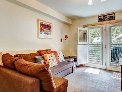 Photo for Lovely riverfront condo w/ shared pool & hot tub - in town & near the slopes!