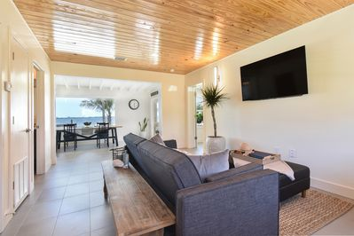 Living Room over looking dining area and Banana River.