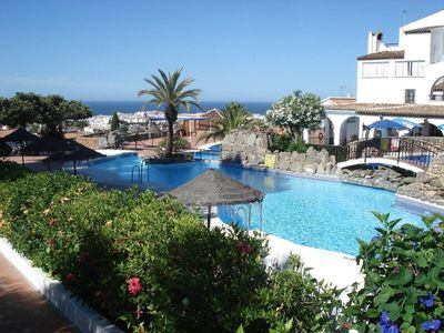 Photo for Capistrano, Nerja 2 bedrooms with large terrace and garden right by the pool
