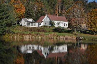 looking at house from swimming pond