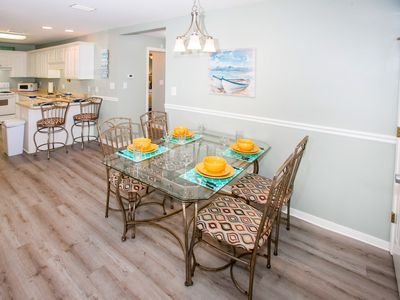 Dining Room - Savor vacation meals at the dining table set for 4.