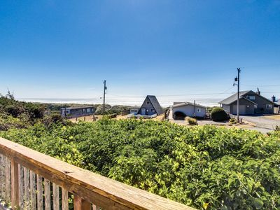 Photo for Unique cottage boasts oceanfront location & private balcony
