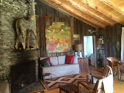 Living room with wood burning fireplace. Couches in living room sleep 2 more!