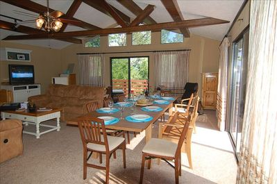 Great room with lake views and dinning table for 14. Additional table available.