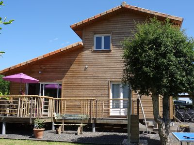 Photo for New wooden house with garden, near the ocean.