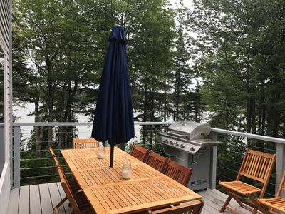 Newly redone deck with stainless cabling to maximize the view. Seating for 10