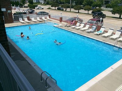 Photo for Bright, clean,  renovated 1BR condo! Overlooks heated pool, 1/2 blk to beach!