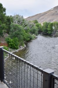 Photo for Overhanging the River! Barbecue on your deck right over the River!
