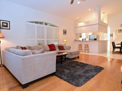 Open & inviting floor plan with lots of windows with wooden shutters