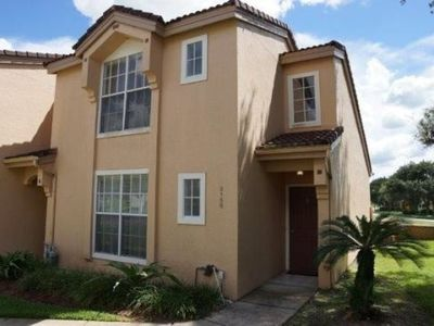 Photo for Spacious 2 bed 2 bath townhome with heated community pool & spa at gated community Mango Key near Disney, Orlando, Florida