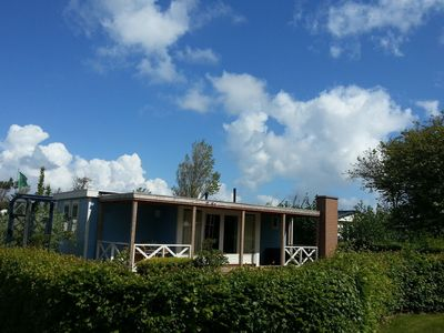 Photo for Luxury comfortable chalet in a holiday park, directly situated by the Waddenzee.