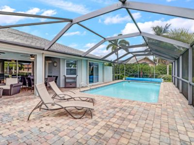 Photo for 3/2 Gulf Access, South Exposure, Heated Pool. Minutes to Cape Harbour.