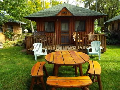 comfy front porch rocker with a beautiful lake view waits for you