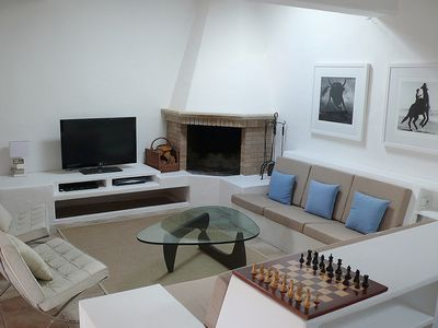 Stylish living room with satellite TV and blu-ray