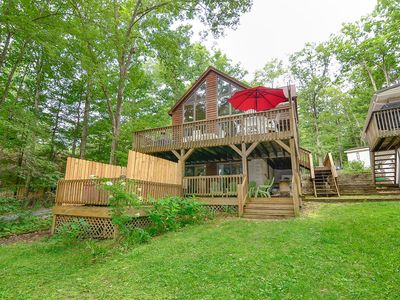 Dog friendly lakefront home with private dock, hot tub, game tables and fire pit!