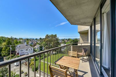 Main balcony with living room and master bedroom access. - Main balcony with living room and master bedroom access.