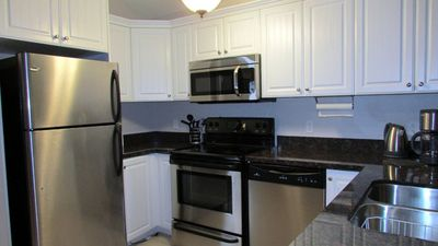 Fully equipped self-catering kitchen with granite counter tops, cathedral ceilings boasting an open concept design.