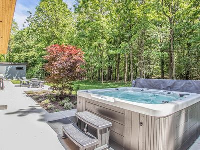 Photo for Modern getaway in a quiet setting w/ private hot tub & outdoor shower!