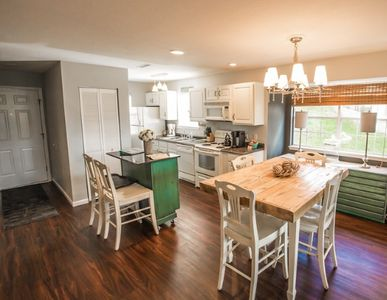 An open and spacious floor plan with a rolling island to configure as you please